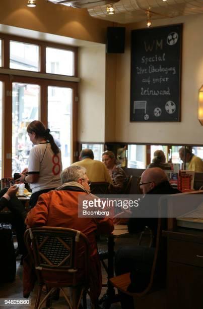 A waitress wearing a soccer shirt serves a customer at Cafe Extrablatt in Gelsenkirchen Germany Wednesday May 31 2006 Gelsenkirchen a former coal...