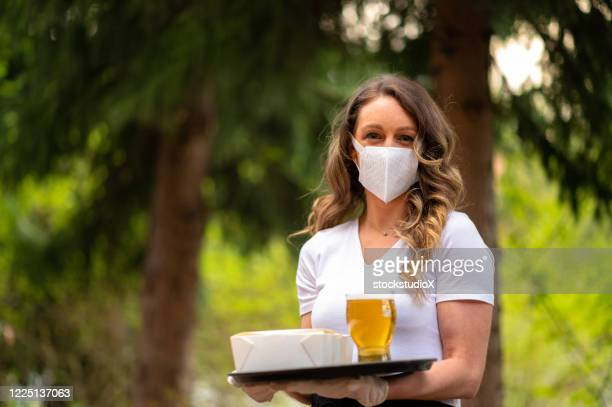 waitress wearing protective equipment for covid - opening event stock pictures, royalty-free photos & images