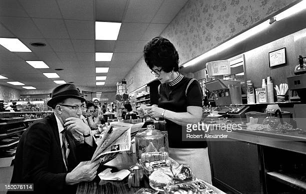 A waitress with a beehive hairdo takes orders at the counter in a drugstore restaurant in Saltville Virginia 5104602RA_Appalachia35jpg