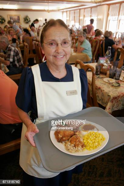 A waitress with a plate of food at The Blue Gate Restaurant and Bakery