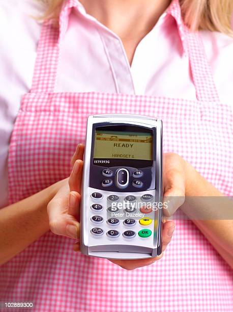 Waitress with chip and pin machine