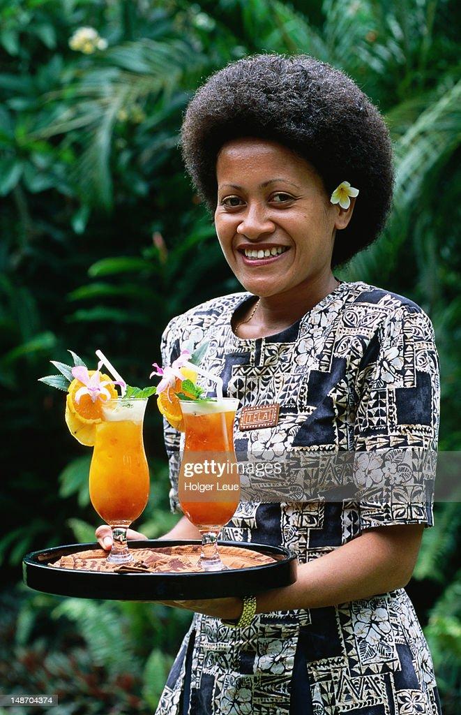Waitress with cocktails, Wakaya club. : Stock Photo