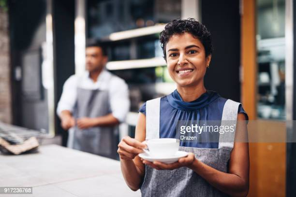 Waitress with cup of coffee