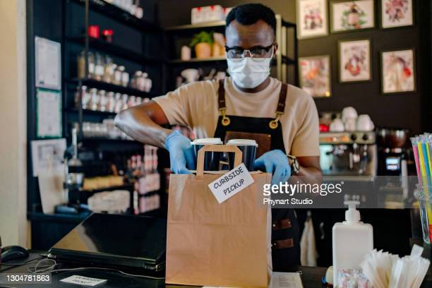 waitress with face mask prepare order for curbside pick up and takeout - glove stock pictures, royalty-free photos & images