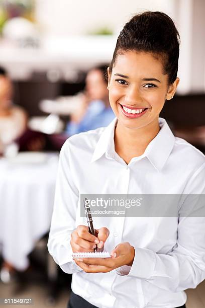 Waitress With Order Pad And Pen At Restaurant