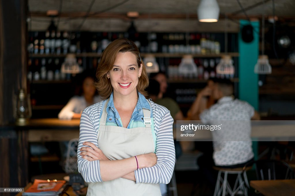 Waitress working at a restaurant : Stock Photo