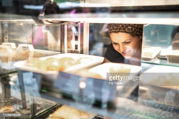 waitress working in restaurant - pão de queijo and empadas - queijo stock pictures, royalty-free photos & images