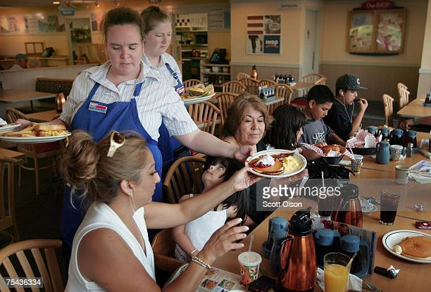 Waitresses Gretchen Boren and Michelle Enright wait on customers at an IHOP restaurant July 16 2007 in Elgin Illinois IHOP Corp has agreed to...