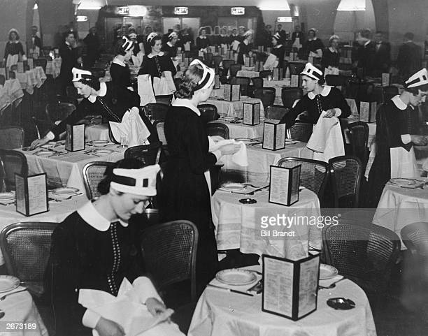 Waitresses or 'nippies' at a Lyon's Corner House London on the first day of opening