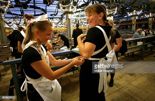 Waitresses put on their aprons in the early morning hours at the Schottenhamel beer tent on September 19 2009 in Munich Germany Oktoberfest is...