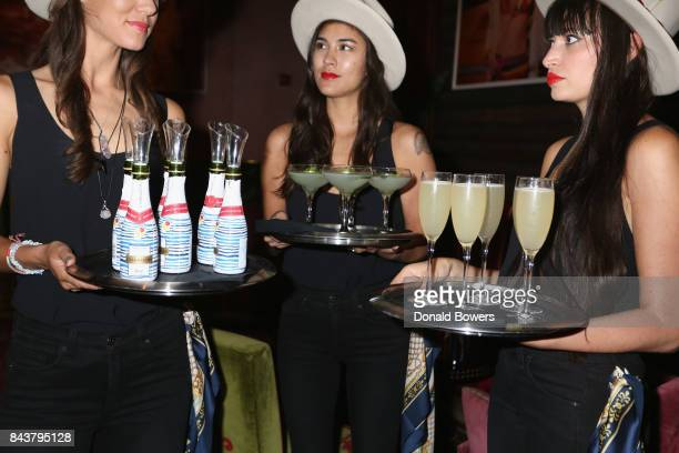 Waitresses serve cocktails at the launch of Mission Magazine with Belvedere Vodka at Rose Bar at Gramercy Park Hotel on September 6 2017 in New York...