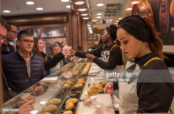Waitresses serve codfish cake and Madeira wine to customers in Casa Portuguesa do Pastel de Bacalhau in Rua Augusta on December 9 2017 in Lisbon...