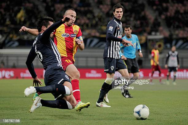 Wajdi Bouazzi of Esperance Sportive de Tunis challenge for the ball with Miguel Morales of Monterrey during the FIFA Club World Cup 5th Place match...