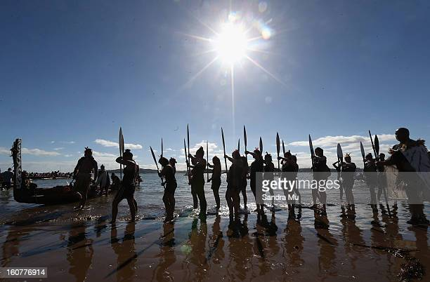 Waka Ama crew perform on the beach to celebrate Waitangi Day on February 6 2013 in Waitangi New Zealand The Waitangi Day national holiday celebrates...