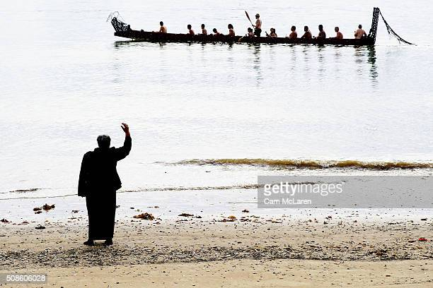 Waka are welcomed to the beach on February 6 2016 in Waitangi New Zealand The Waitangi Day national holiday celebrates the signing of the treaty of...