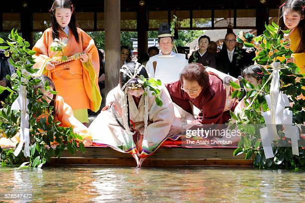 Waka Nishimura wearing a 12layered ceremonial kimono called 'Junihitoe' performs the 'MisoginoGi ' at Kamigamo Jinja Shrine ahead of Aoi Matsuri...