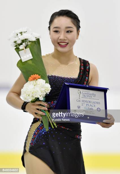 Wakaba Higuchi of Japan poses on the podium after finishing second with a personal best total of 21763 at the Lombardia Trophy in Bergamo Italy on...