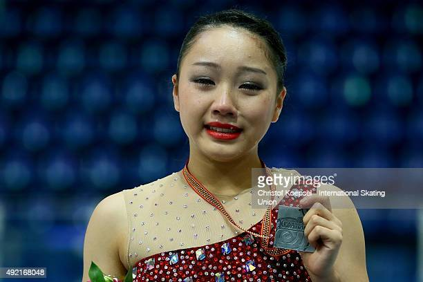 Wakaba Higuchi of Japan presents her silver medal during the medal ceremony of the junior ladies free skating of the ISU Junior Grand Prix at Dom...