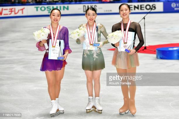 Wakaba Higuchi Rika Kihira and Tomoe Kawabata of Japan pose with their medals during day three of the 88th All Japan Figure Skating Championships at...