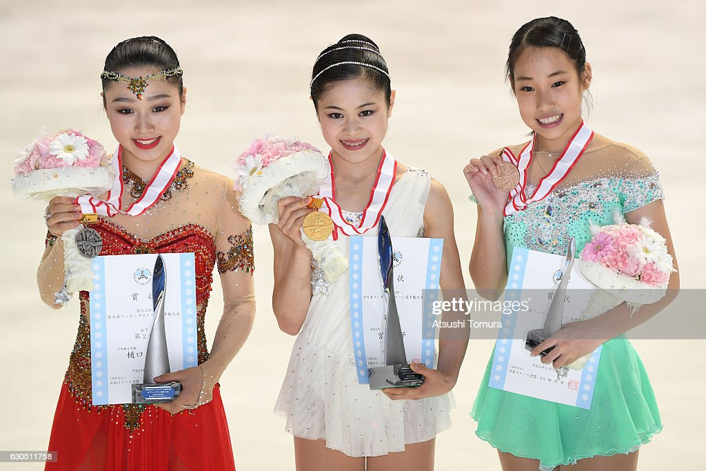 Wakaba Higuchi (silver), Satoko Miyahara (gold) and Mai Mihara (broze) of Japan pose with their medals after the Ladies free skating during the Japan Figure Skating Championships 2016 on December 25, 2016 in Kadoma, Japan.