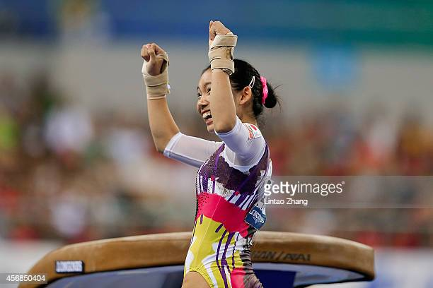 Wakana Inoue of Japan celebrates after competing on the vault during the Women's Team Final on day two of the 45th Artistic Gymnastics World...