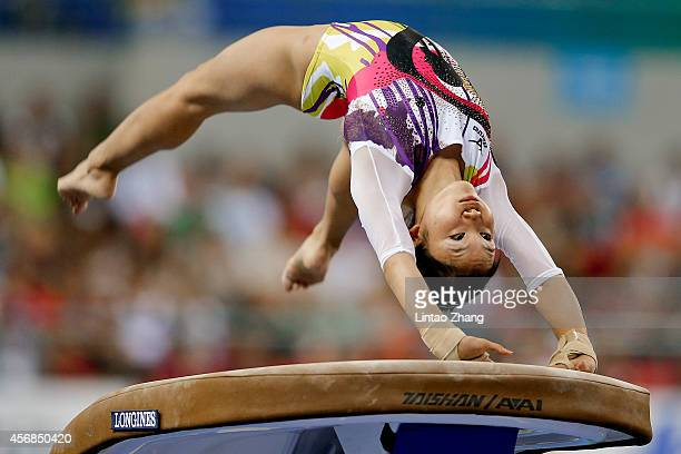 Wakana Inoue of Japan competes on the vault during the Women's Team Final on day two of the 45th Artistic Gymnastics World Championships at Guangxi...