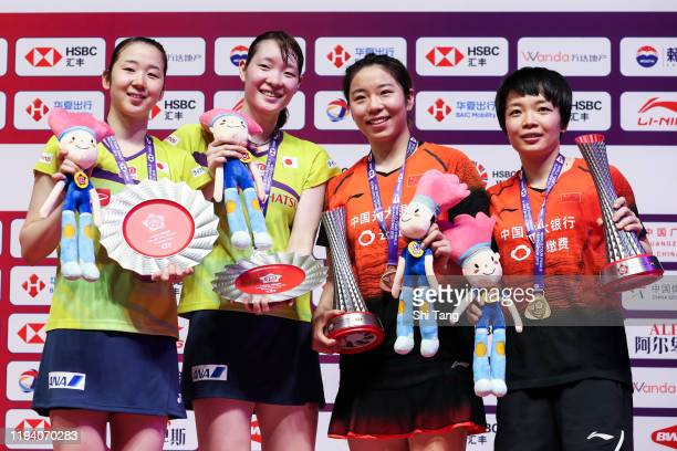 Wakana Nagahara and Mayu Matsumoto of Japan, Jiayifan and Chen Qingchen of China pose with their trophies after the Women's Double final match during...