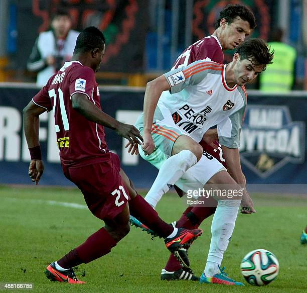 Wakaso Mubarak of FC Rubin Kazan is challenged by Aleksandr Yerokhin of FC Ural Sverdlovsk Oblast during the Russian Football League Championship...