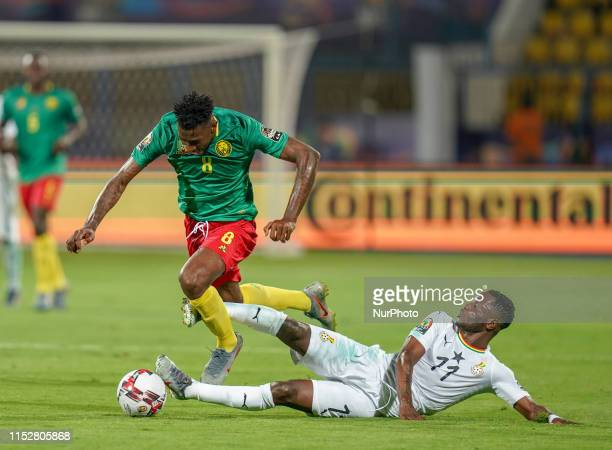 Wakaso Mubarak of Ghana fouls Andre Franck Zambo Anguissa of Cameroon during the 2019 African Cup of Nations match between Cameroon and Ghana at the...