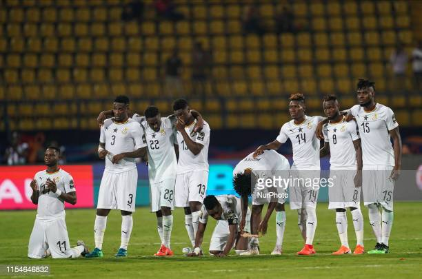 Wakaso Mubarak of Ghana praying with the Ghanian team during the 2019 African Cup of Nations match between Ghana and Tunisia at the Ismailia Stadium...