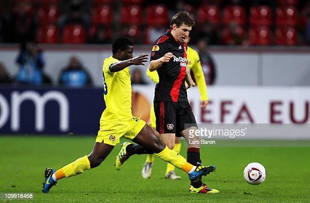 Wakaso Mubarak of Villarreal challenges Daniel Schwaab of Leverkusen during the UEFA Europa League round of 16 first leg match between Bayer...