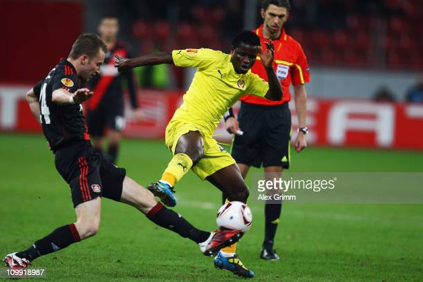 Wakaso Mubarak of Villarreal is challenged by Michal Kadlec of Leverkusen during the UEFA Europa League round of 16 first leg match between Bayer...