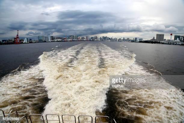 Wake behind luxury yacht in Tokyo Bay