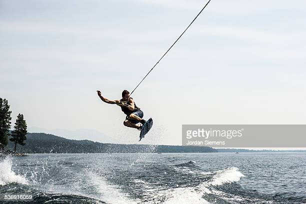 wake boarding on a lake - waterskiing stock photos and pictures