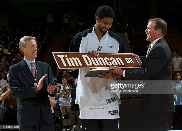 Wake Forest Athletic Director Ron Wellman and WinstonSalem mayor Allen Joines present Tim Duncan with a street sign to commemorate a portion of...