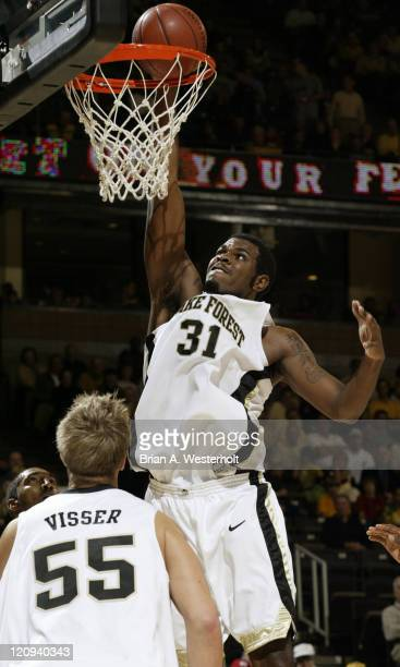 Wake Forest center Eric Williams raises up to slam home 2 of his 14 points on the night as the ranked Demon Deacons defeated the visiting...