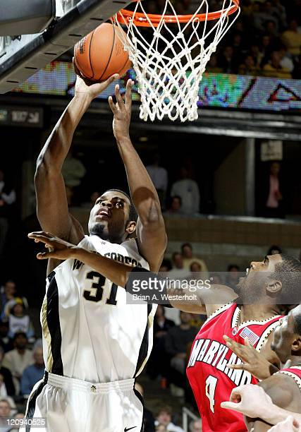 Wake Forest center Eric Williams shoots over Maryland's Travis Garrison for 2 of his 12 points on the night as the Demon Deacons defeated the...