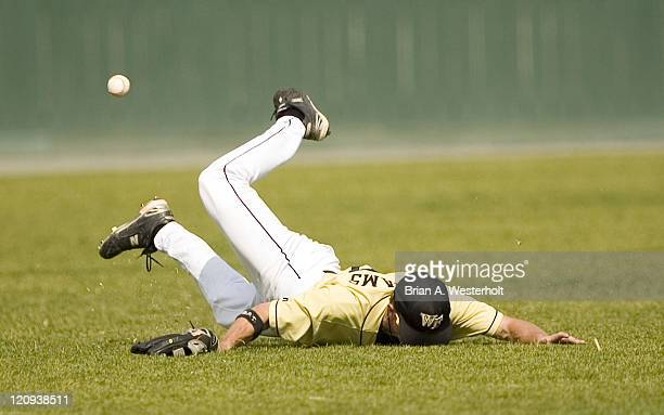 Wake Forest center fielder Eric williams comes up a bit short on his attempt to catch a shallow fly ball off the bat of North Carolina's Matt Spencer...