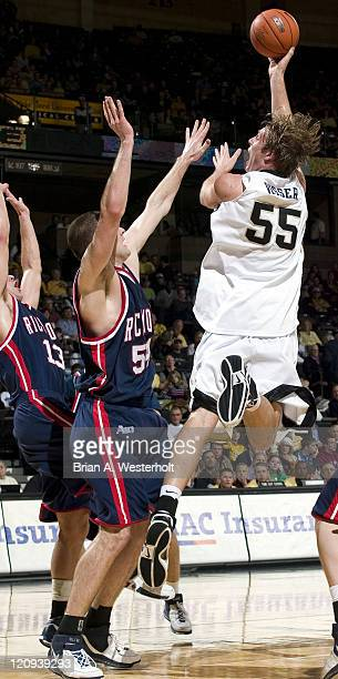 Wake Forest center Kyle Visser tries to shoot over Richmond center Drew Crank during first half action at the LJVM Coliseum in Winston-Salem, NC,...