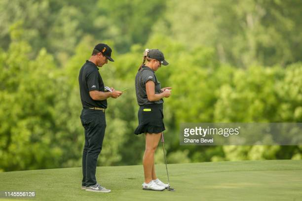Wake Forest coach Ryan Potter looks at a putt with Jennifer Kupcho of Wake Forest University during the Division I Women's Golf Match Play...