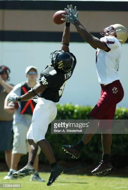 Wake Forest cornerback Eric King breaks up a pass in the end zone intended for Boston College wide receiver Grant Adams during first quarter action...