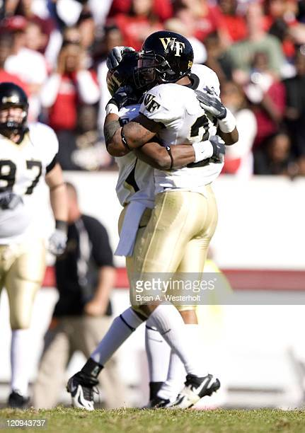 Wake Forest defensive back Josh Gattis is hugged by teammate Kevin Patterson following Gattis' 4th quarter interception that sealed the Demon...