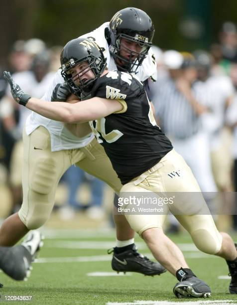 Wake Forest defensive end Matt Robinson tries to get around the block of offensive lineman Jeff Griffin at the Spring Game on the campus of Wake...