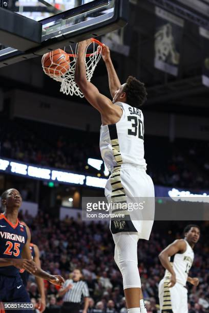 Wake Forest Demon Deacons center Olivier Sarr gets a dunk against the Virginia Cavaliers during the ACC matchup on January 21 2018 between Virginia...