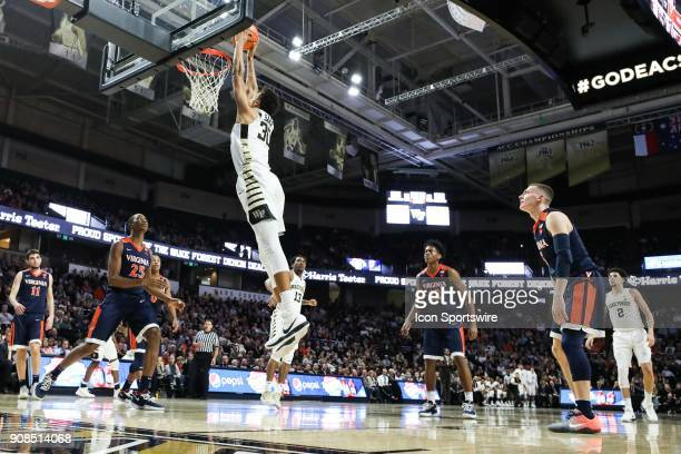 Wake Forest Demon Deacons center Olivier Sarr gets a dunk on Virginia Cavaliers forward Mamadi Diakite during the ACC matchup on January 21 2018...