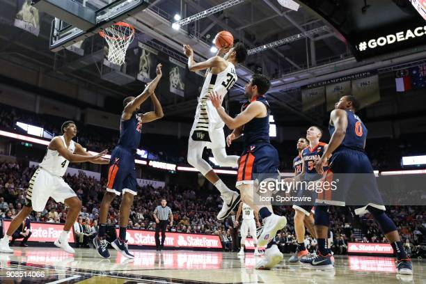 Wake Forest Demon Deacons center Olivier Sarr goes up for a shot over Virginia Cavaliers forward Isaiah Wilkins during the ACC matchup on January 21...