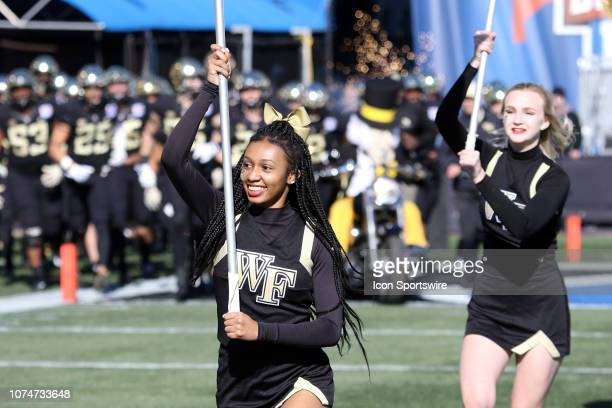 Wake Forest Demon Deacons cheerleaders lead the team onto the field for the Birmingham Bowl between the Memphis Tigers and the Wake Forest Demon...