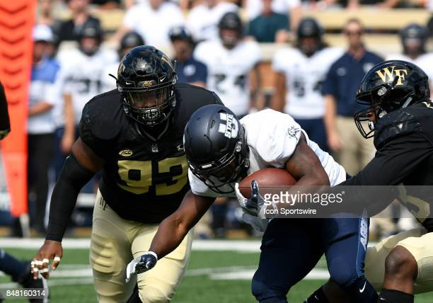 Wake Forest Demon Deacons defensive lineman Zeek Rodney comes in for the hit on Utah State Aggies running back LaJuan Hunt as Wake Forest Demon...