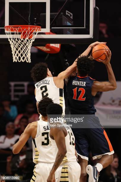 Wake Forest Demon Deacons forward Donovan Mitchell blocks a shot by Virginia Cavaliers guard De'Andre Hunter during the ACC matchup on January 21...
