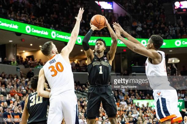 Wake Forest Demon Deacons Forward Isaiah Mucius shoots the ball over Virginia Cavaliers Forward Jay Huff and Virginia Cavaliers Guard De'Andre Hunter...